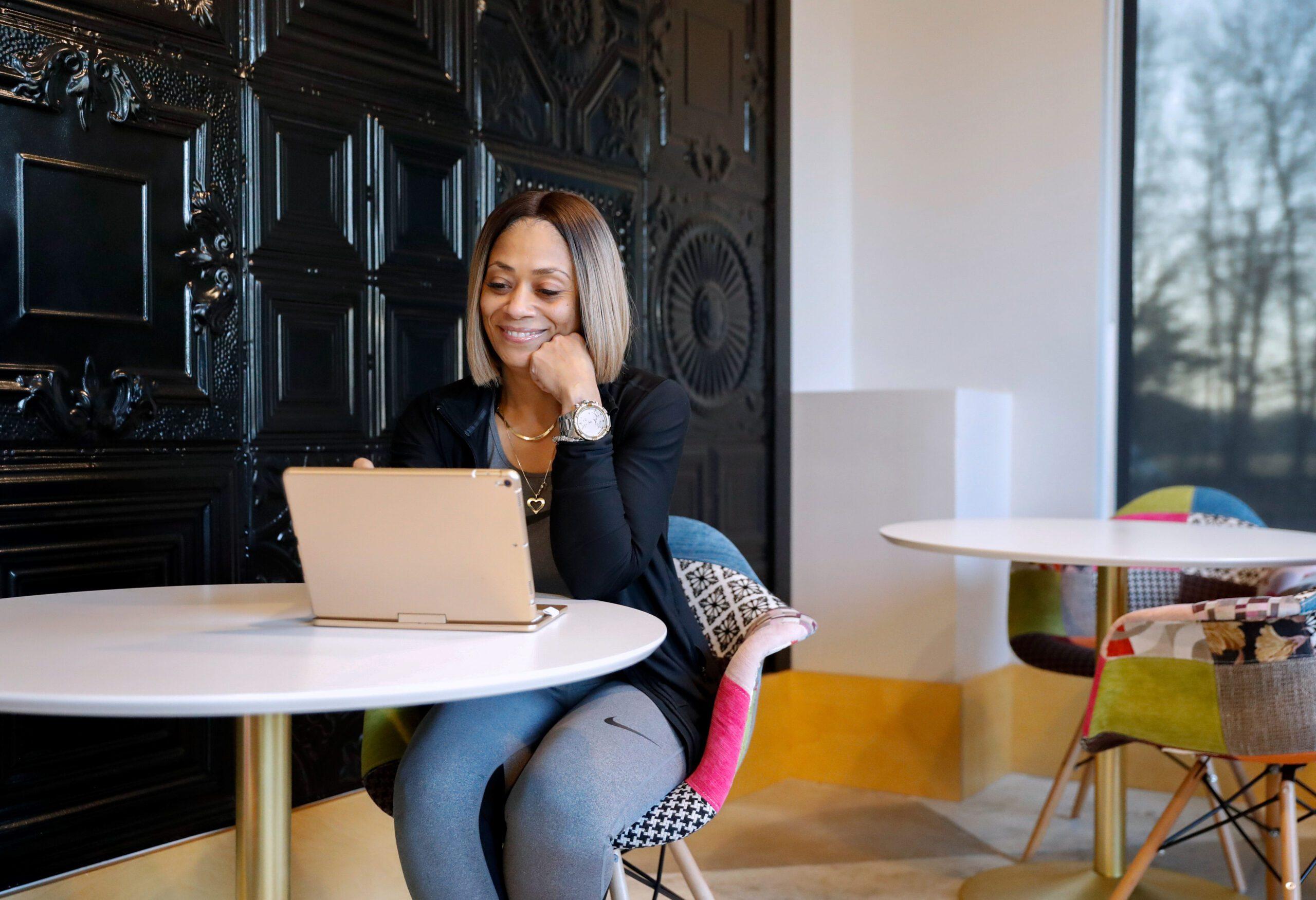 A woman working in a coworking space at Caddo Office Reimagined